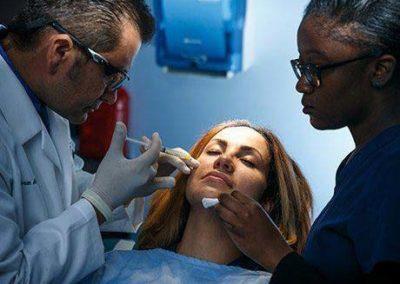 Dr. Amir injecting patient
